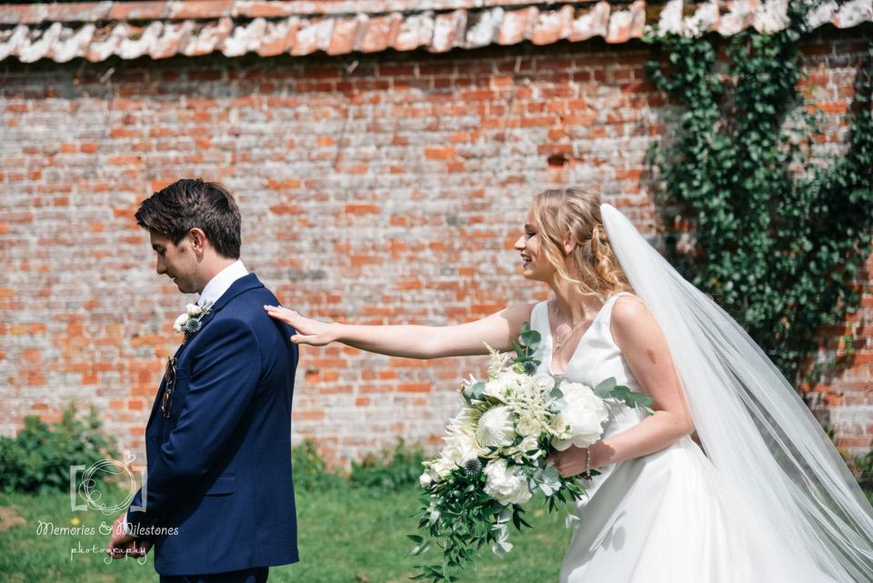 devon wedding photographer first look photo
